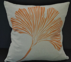 Hand stenciled copper colored ginkgo leaf on a dark natural linen square pillow by 2 faced linen