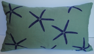 Hand stenciled periwinkle starfish on a light green linen lumbar pillow by 2 faced linen