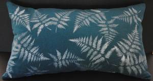 Hand stenciled white ferns on a turquoise linen lumbar pillow by 2 faced linen