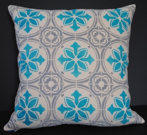 Hand stenciled grey and turquoise tile design on a light natural linen square pillow by 2 faced linen