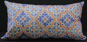 Hand stenciled blue and orange tile design on a white linen lumbar pillow by 2 faced linen