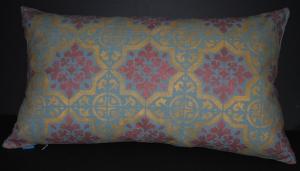 Hand stenciled brass and rosegold tile on a grey linen lumbar pillow