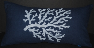 Hand stenciled white coral on a navy blue linen lumbar pillow