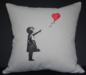 Hand stenciled Banksy design girl with red balloon on a light natural square pillow by 2 faced linen