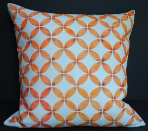 Hand stenciled burnt orange geometric design on a white linen square pillow by 2 faced linen