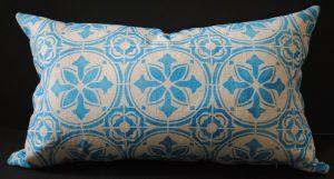 Hand stenciled blue tile design on a light natural linen lumbar pillow by 2 faced linen