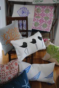 An assortment of hand stenciled linen pillows by 2 faced linen