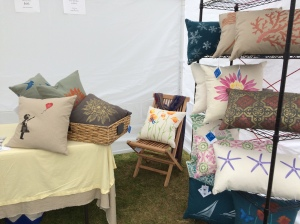 Hand stenciled pillows on display at Boothbay Railway Village Fall Foliage craft fair