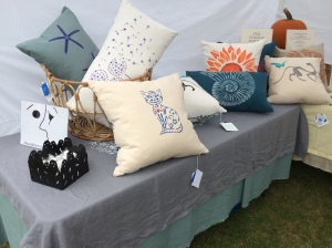 Hand stenciled pillows on display at the Boothbay Railway Village Fall Foliage craft fair