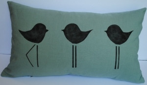 Hand stenciled black sandpipers on a light green linen lumbar pillow by 2 faced linen