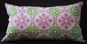 Hand stenciled pink and green tile design on a white linen lumbar pillow by 2 faced linen