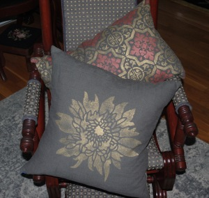 Hand stenciled gold marigold and rose gold tile design on charcoal square and lumbar pillows by 2 faced linen