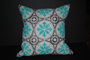 Hand stenciled turquoise and black tile design on a white linen square pillow by 2 faced linen